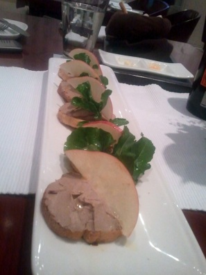 Chunky Chicken Liver Pate topped with sliced apple and rocket leaves on a pointless balsamic vinegar drizzle