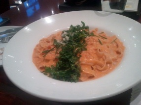 Smoked Chicken tossed in a creamy, tomato flavoured sauce with fettucini and Arugula