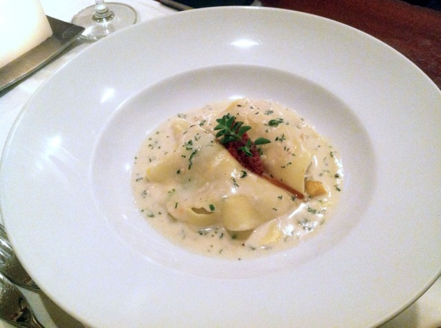 "Prawn ""Raviolo"" in a White Wine Nage. Roasted Pumpkin, Peas and Roasted Tomato Pesto. Smelled so lovely, tasted ok."