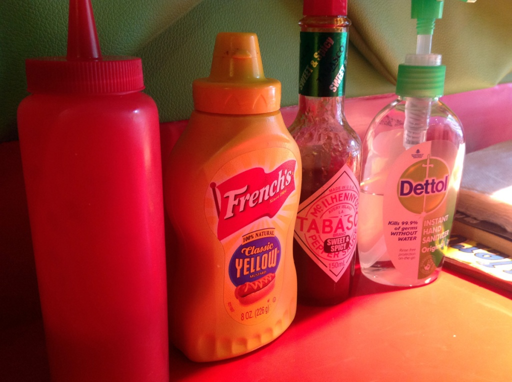 Since they don't have a washroom or wash basin, hand sanitiser is thoughtfully kept on every table along with the condiments