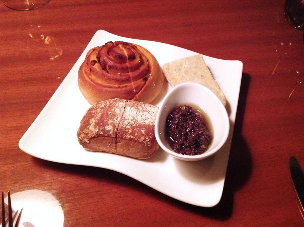Top L- R Tomato Foccacia, unsalted bread, black olive dip, Ciabatta