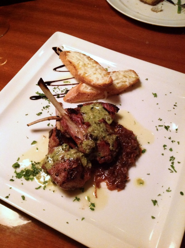 Mediterranean herb crusted lamb rack, caramelized scallions and basil sauce with Pecorino crostini