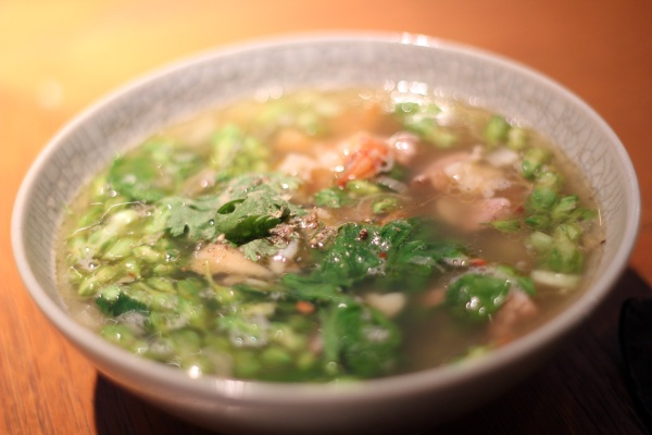 Clear soup of minced pork and pork with kajorn flowers and squid