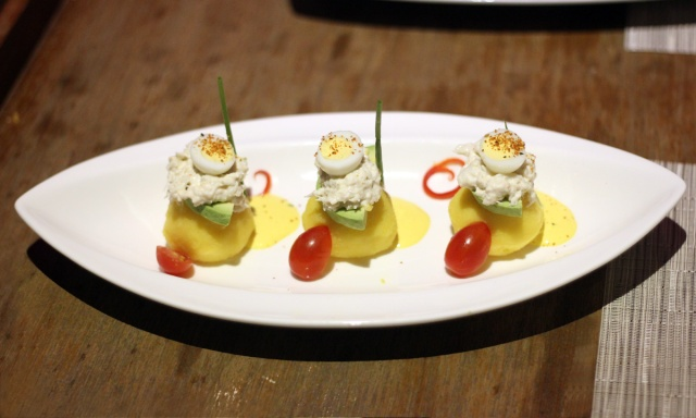 Mashed potatoes topped wth crab meat in a togarashi mayo with avocade, quail egg and and huacaina sauce Above 11, Bangkok