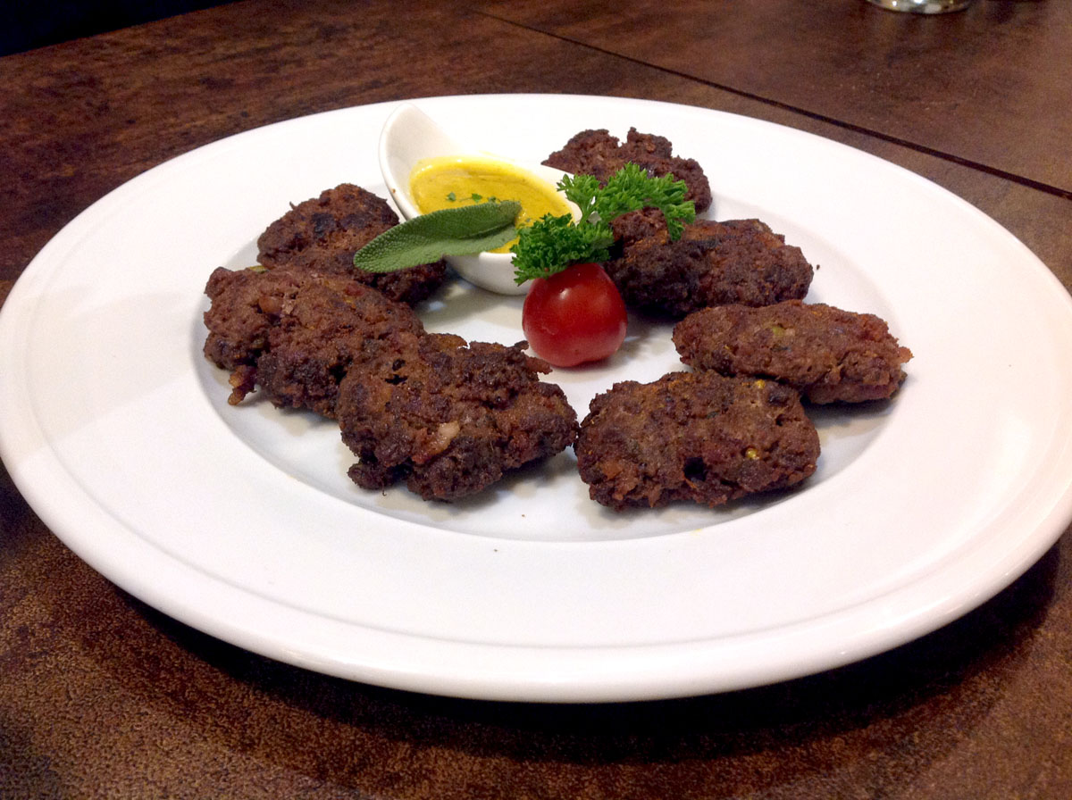 Spicy beef, bacon and duck cakes Imbiss, Colaba
