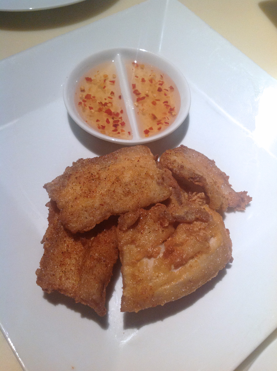 Crumb fried pork belly crisps, in a tangy marinade, served with a sweet chilli dip Blue Frog, Mumbai