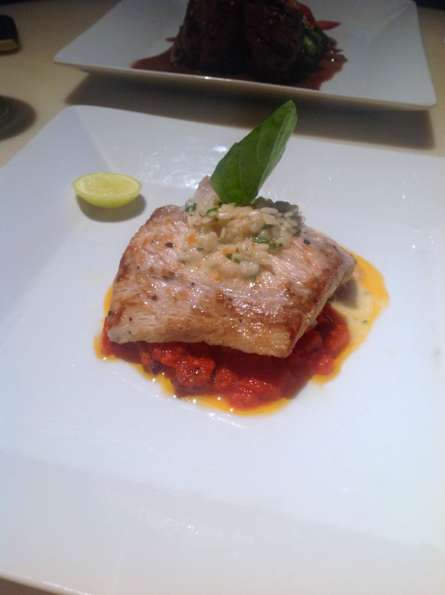 Fish Provencal, baked & served on a bed of tomato sauce, mushrooms & olive oil Blue Frog, Mumbai