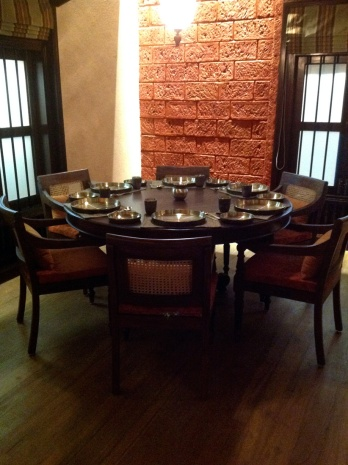 Corner table set against a laterite brick wall