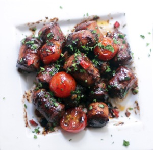 Sausages tossed in a rum-flavoured, spicy chocolate glaze