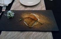 Gunpowder Spiced bekti slice on a crud rice sauce with curry leaf powder and tamarind sugar