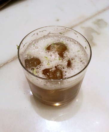 An Indian version of Cuba Libre with Old Monk, black salt and gated Yuzu