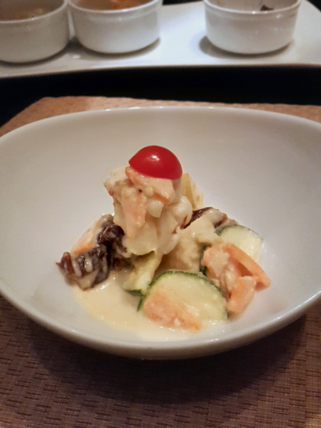 Lobster medallion with cucumber, dates and pear in a mustard sauce