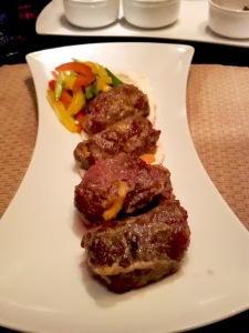 Wrapped beef rolls with a sesame sauce