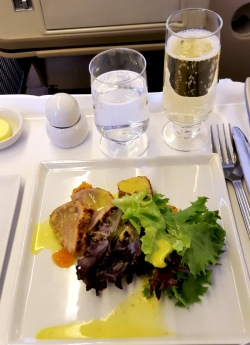 Singapore Airlines Business Class meal with champagne