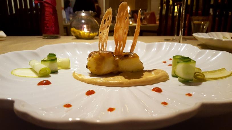 Baked Sea Bass with Yuzu Miso: roasted cauliflower mash pickled cucumber, bell pepper sauce, yuzu miso sauce