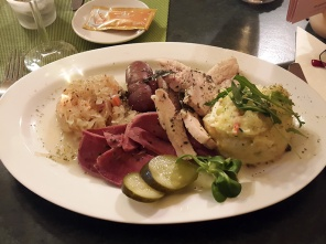 Blood sausage, liver sausage, braised pork belly and pork tongue with savoury mashed potatoes and slaw, Leipzig