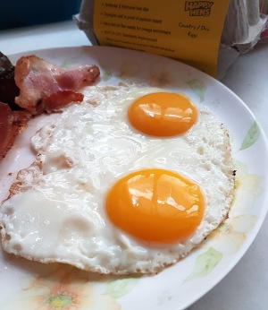 Happy Hens fried eggs with bacon